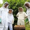 Local beekeepers tend their hives to keep our planet healthy and alive