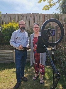 Reverend Martin Hills and Carita Hills film a service for the Oundle Baptist Church